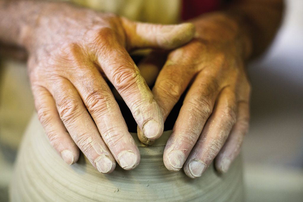 heritage in hand Ellington (left) is carrying on an art form that found its real strength in the distinct stoneware clay of the Catawba Valley.