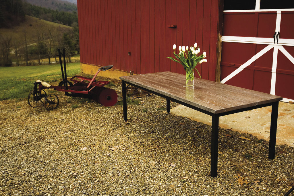 The Harvest Steel table (shown in American Chestnut) is among the myriad collections of furnishings produced by The Old Wood Co. in Asheville.