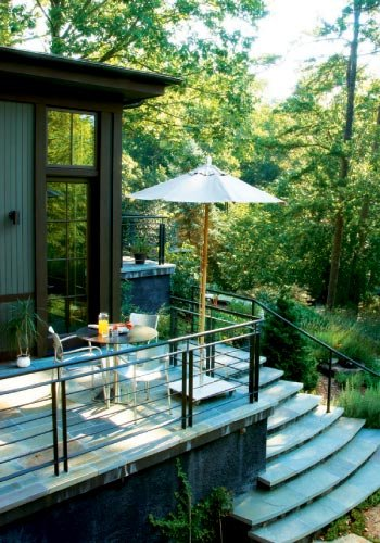 Garden Variety: a side patio serves as an alfresco breakfast nook with steps leading to the pond.