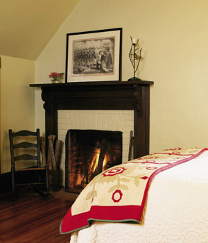 The fireplaces in the master bedroom and the cozy, book-filled living room make the spaces inviting.