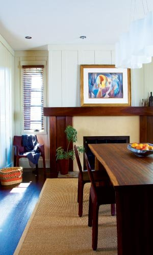 Artistic Flourishes: Ceramist Josh Copus created the vessels on the mantle and a wood-fired bowl that sits atop the walnut dining table from Central Station in High Point. The pastel above the fireplace is by Will Henry Stevens.