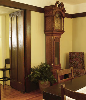 Found in pieces, the eight-foot-tall English clock was restored by Pisgah Forest's Bob Perkins.