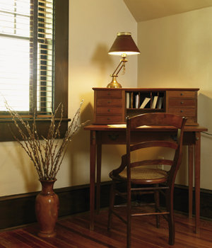 """A cherry writing desk by  furniture maker Walter Cantrell sits the guest bedroom. """"I just fell in love with it as soon as I saw it,"""" Veronica says."""