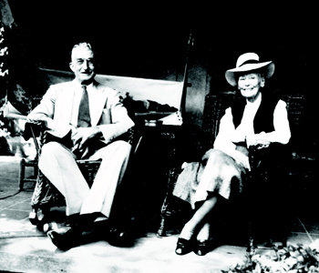Royal and Louise Morrow on the porch of Stone Cottage.