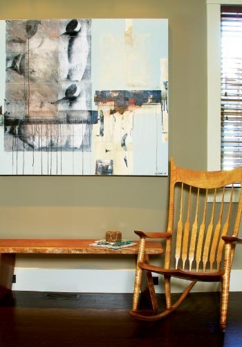 Living Room:  Michelle and Paul visited the studio of Werner Haker in Brevard to select a painting, which hangs in the living room above a chair crafted by Sam Maloof.