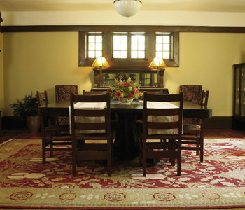 In the dining room and throughout the home rich wood moldings trace the windows.