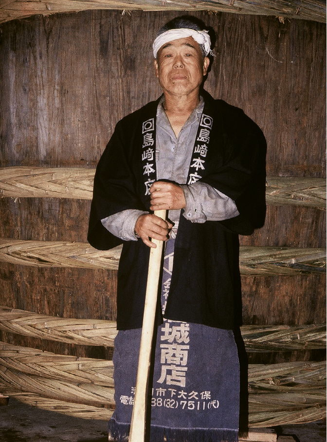 Expert barrel maker Arai-san in a photo that would provide the inspiration for the Miso Master logo