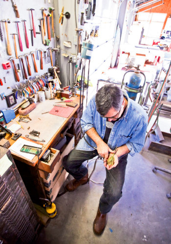 Sherrill uses a host of tools to sculpt his works in metal, glass, and clay.