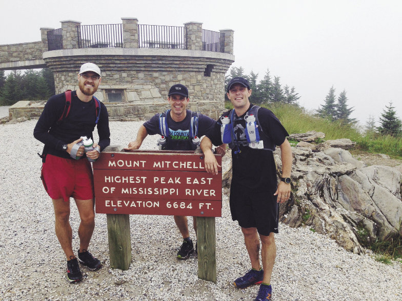 From left, Jonathan, Eric, and Jason pause for an early refuel and photo atop Mt. Mitchell, the highest peak in the East at 6,684 feet.