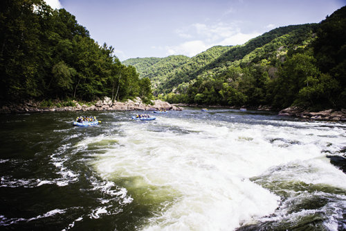 Running north from Ashe County in WNC to meet with the Class V Gauley in West Virginia, the New River is among the world's oldest waterways. Its Class III to V rapids in the New River Gorge offer white-water thrills. Ace Raft is among the many operators that will take you down the river.