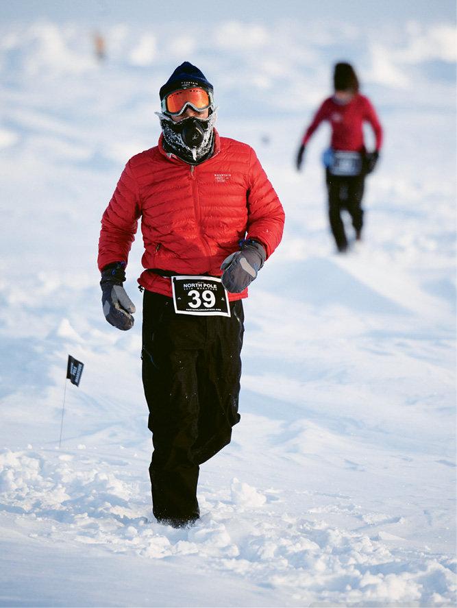 Thompson running the North Pole Marathon, the northernmost marathon on Earth