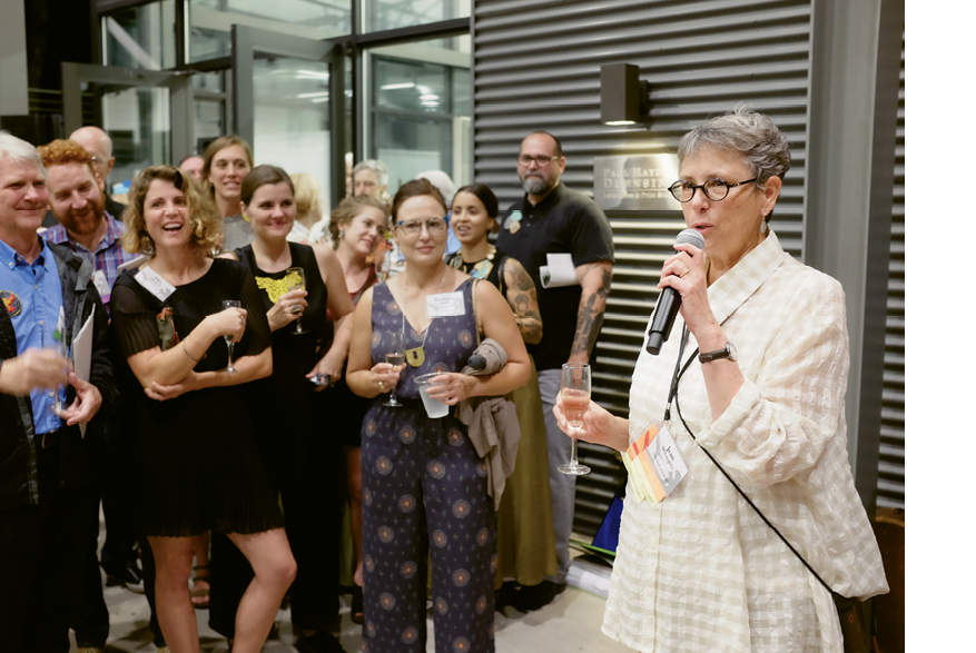 Penland Executive Director Jean McLaughlin toasts the crowd on Friday night.