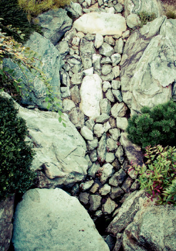 Artisitc Element Water, here shown as a symbol, in the form of a stone stream, is integral to Japanese gardens