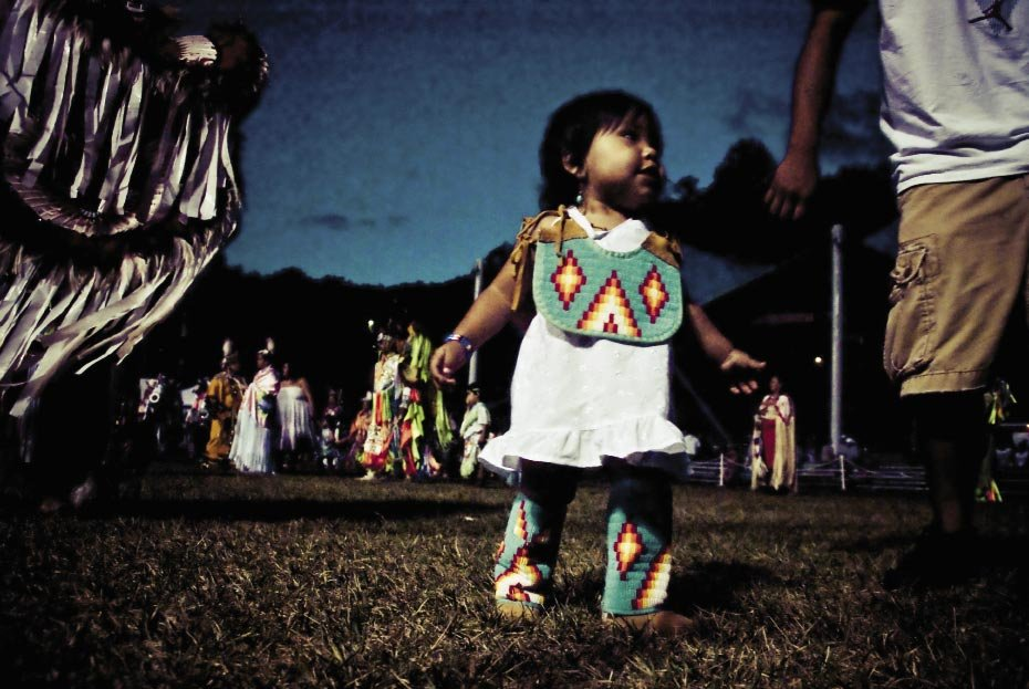 """Tiny dancer Opposite, the pow wow is a family event, with competitions for children as young as  toddlers.""""As I was sitting on the sideline, this little dancer swooped in for a closer look at my camera after an intertribal dance, which invites everyone into the ring to show off their best moves."""""""