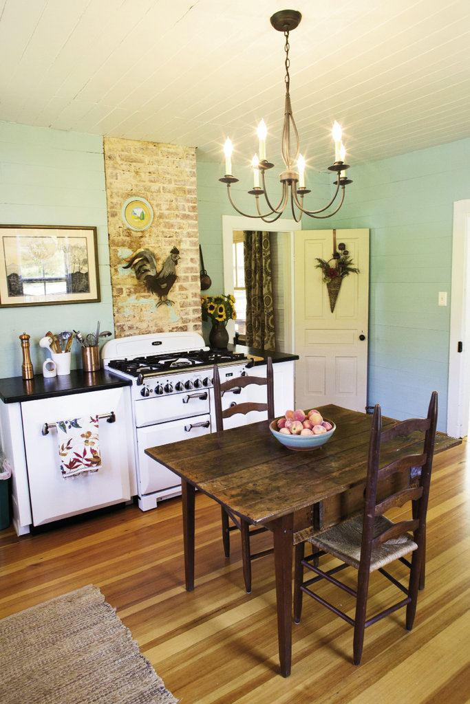 in the eat-in kitchen, the brick chimney and plank walls keep the room rustic and true to its roots.