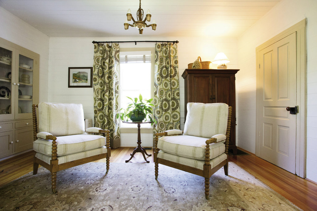 the linen upholstered spool chairs make the formal sitting room a cozy spot for conversation.