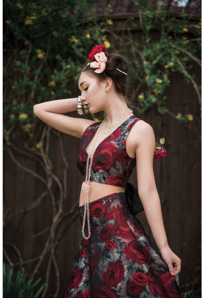 A rose brocade flare skirt and crop top set modeled by Aislin Freya Pax