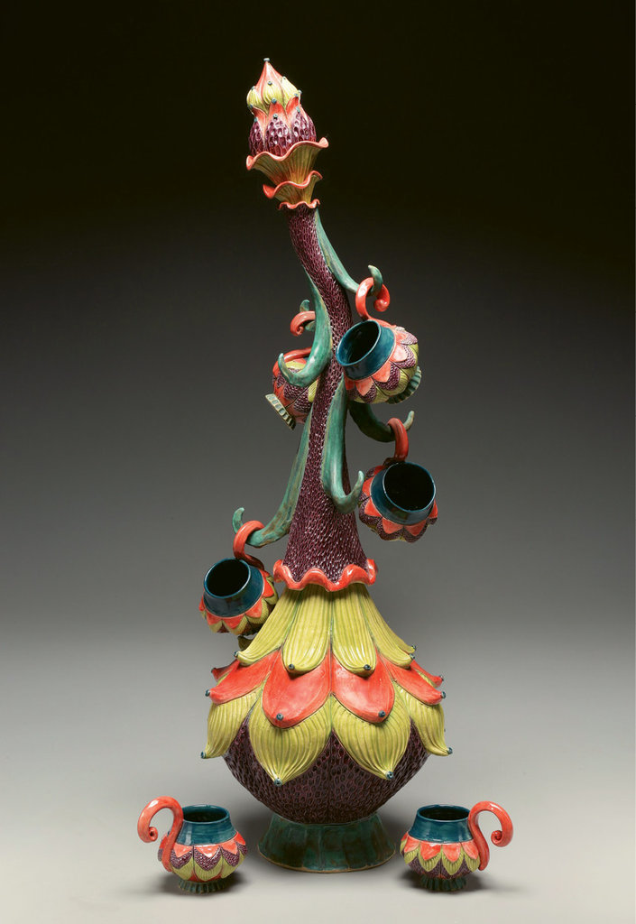 "Sherburne's ""mug tree,"" with its curving stalk, creatively stores a collection of cups."