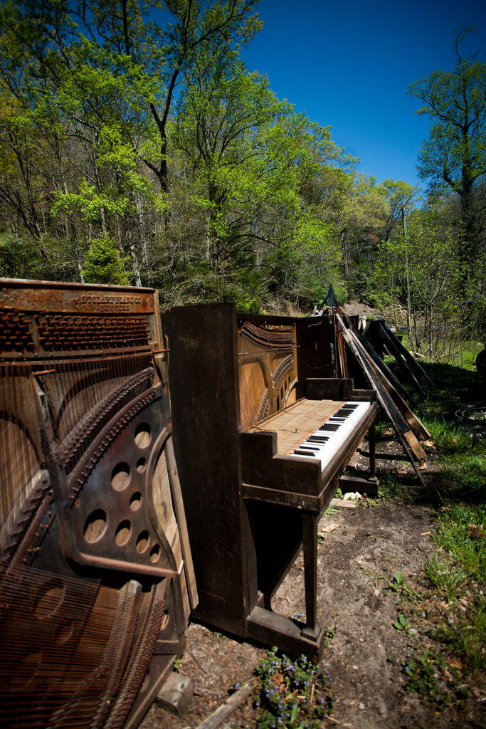 The couple weathers old pianos outside before deconstructing them for parts, which wind up as artworks.