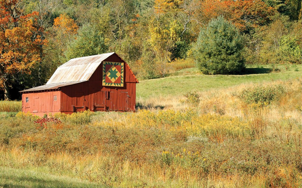 Painted quilt blocks adorn barns and points of interest along the WNC Quilt Trail.