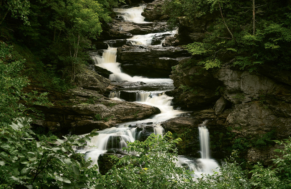 Go With the Flow: Follow Mountain Waters Scenic Byway for views of the Cullasaja River and its three falls.