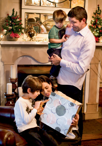 Time to Give Sandra and Gaetano Siano enjoy an early Christmas gift with their sons, Nicolas and Alex. The inn's parlor serves as a cozy and convenient gathering place. Opposite bottom right, Danielle shares a laugh with brother-in-law Gaetano.