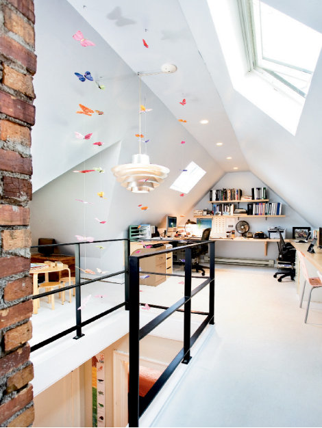 The Huebners transformed their attic into an office for Scott's business, Brickstack Architecture + Design. A ship's ladder gives the family access to 400 additional square feet.
