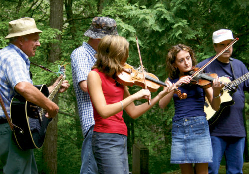Gather Round: As part of the celebration, The Dills Sisters perform at Proctor Cemetery in the Smoky Mountains in 2004