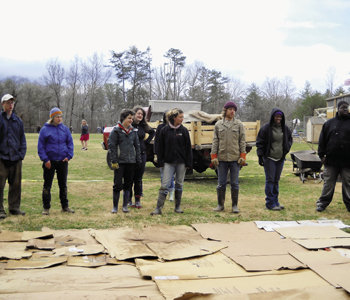 Warren Wilson College students help prepare a growing bed at Evergreen Community Charter School.